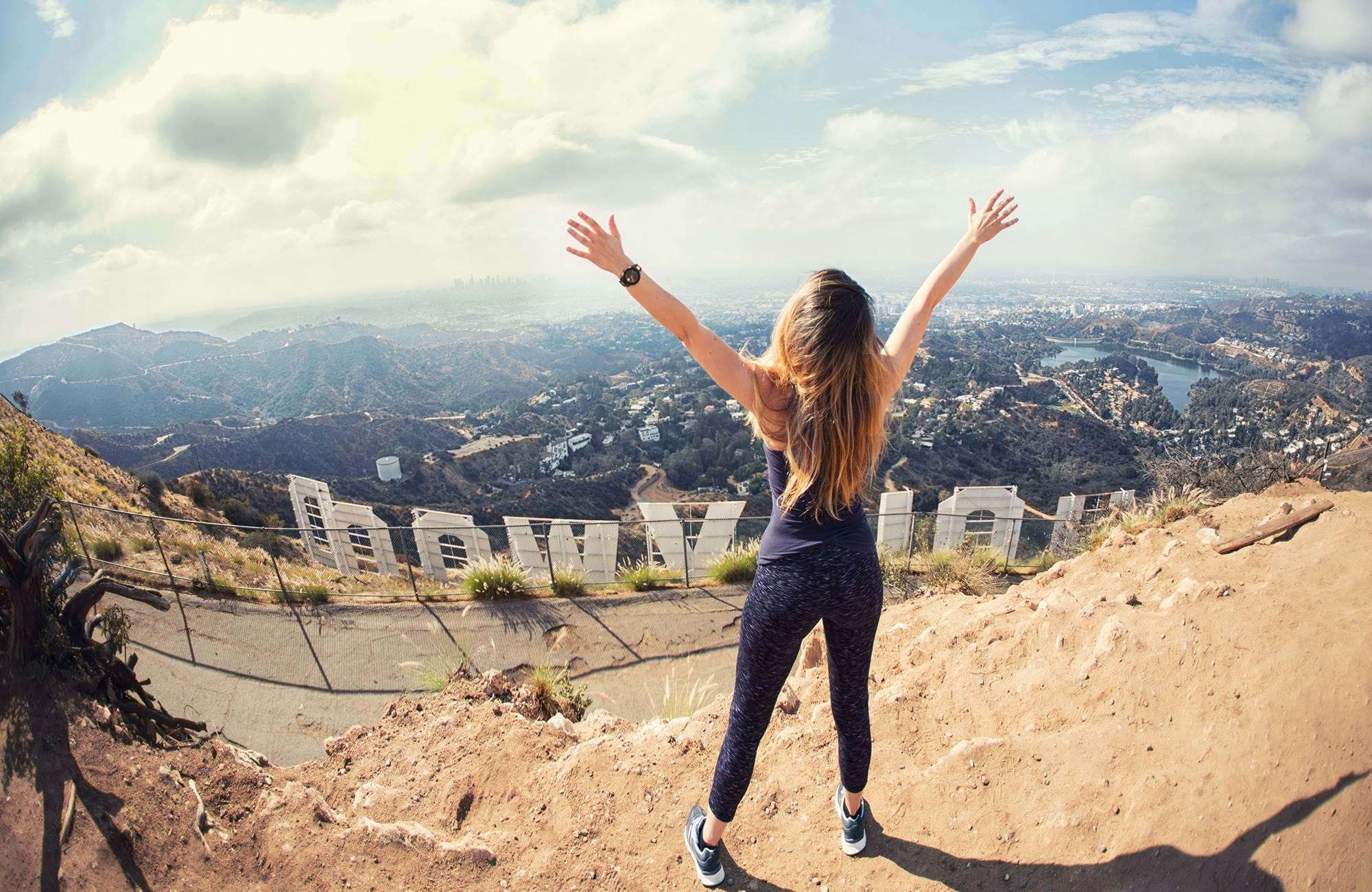 usa-california-los-angeles-woman-behind-hollywood-sign